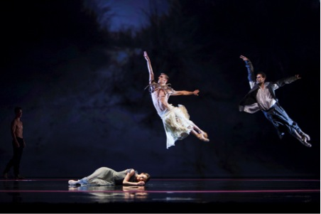 Photograph by Angela Sterling. Jurgita Dronina as Miranda, Koen Havenith as Ariel, and Jozef Varga as Young Prospero