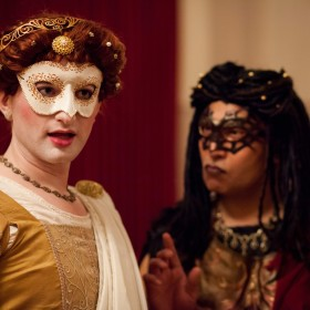 Figure 3: Isto Barton as Comedy and Rommel Sulit as Envy in the induction of Mucedorus. Costumes by Jennifer Davis and Monica Gibson; masks by Jennifer Davis.