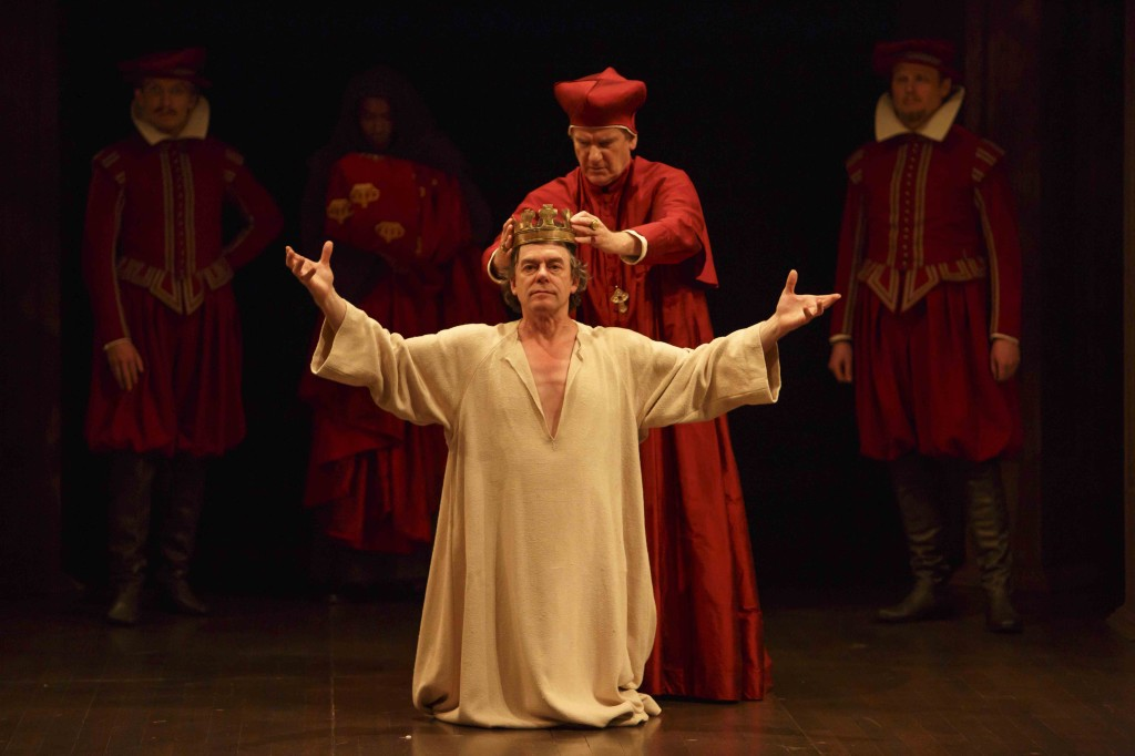 Tom McCamus (centre, left) as King John and Brian Tree as Cardinal Pandulph with members of the company in King John. Photo by David Hou.