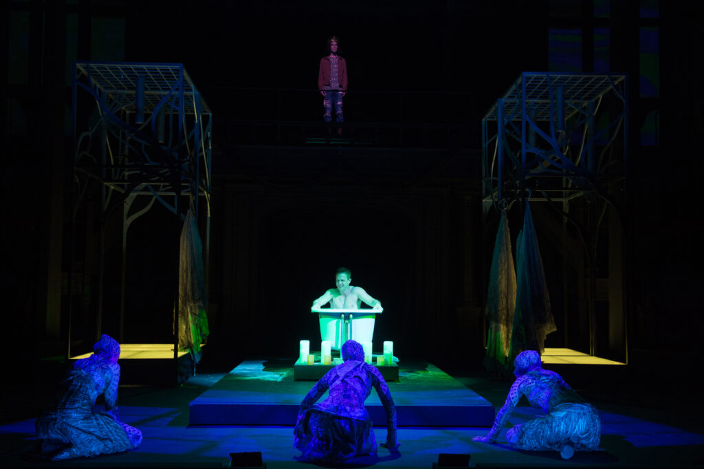 The Oregon Shakespeare Festival. 2019. Macbeth by William Shakespeare. Directed by José Luis Valenzuela. Scenic Design: Christopher Acebo. Costume Design: Chrisi Karvonides-Dushenko. Lighting Design: Pablo Santiago. Projection Design: Micah Stieglitz. Composer/Sound Design: John Zalewski. Dramaturg: Amrita Ramanan. Voice and Text Director: Rebecca Clark Carey. Phil Killian Directing Fellow: Kareem Fahmy. Fight Director: U. Jonathan Toppo. Stage Manager: Jeremy Eisen. Photo: Jenny Graham.