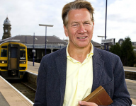 Michael Portillo with his copy of Bradshaw's Guide