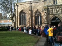 People queuing outside the cathedral