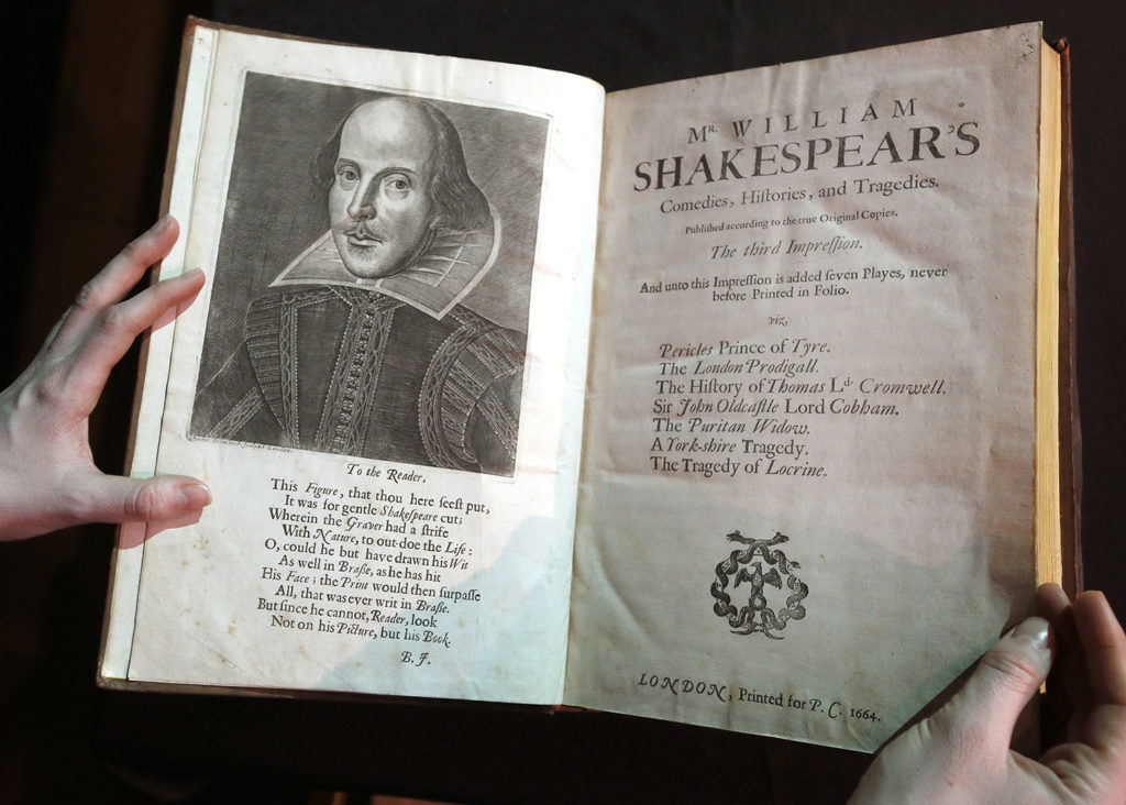 "A portrait of William Shakespeare is seen in the Third Folio, in London, Wednesday, March 16, 2016. The Third Folio is estimated at 300,000-400,000 UK pounds (422,400-563,200 US dollars), includes Pericles for the first time and is illustrated with Shakespeareís iconic portrait by English engraver Martin Droeshout. William Shakespeare died 400 years ago, but his stock has never been higher. To coincide with the anniversary of the Bard's death, Christie's is selling copies of the first four editions of his plays - a collection the auctioneer's head of books, Margaret Ford, calls ""the holy grail of publishing."" The four folios are going on display in New York April 1-8 and London April 20-28 before being sold in London on May 25. (AP Photo/Kirsty Wigglesworth)"