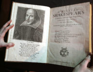"""A portrait of William Shakespeare is seen in the Third Folio, in London, Wednesday, March 16, 2016. The Third Folio is estimated at 300,000-400,000 UK pounds (422,400-563,200 US dollars), includes Pericles for the first time and is illustrated with Shakespeareís iconic portrait by English engraver Martin Droeshout. William Shakespeare died 400 years ago, but his stock has never been higher. To coincide with the anniversary of the Bard's death, Christie's is selling copies of the first four editions of his plays - a collection the auctioneer's head of books, Margaret Ford, calls """"the holy grail of publishing."""" The four folios are going on display in New York April 1-8 and London April 20-28 before being sold in London on May 25. (AP Photo/Kirsty Wigglesworth)"""