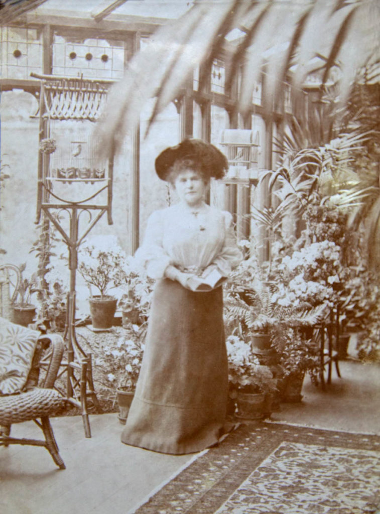Marie Corelli in her conservatory at Mason Croft (now the Shakespeare Institute). She lived there from 1901 until her death in 1924. Photo courtesy of The Shakespeare Birthplace Trust.